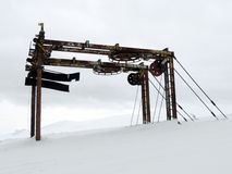Rusty old ski tow in snow Stock Photo