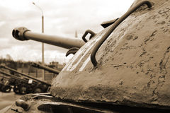 Rusty old soviet military tank. Sepia. Royalty Free Stock Images