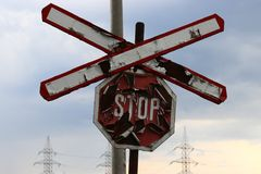 Rusty old stop sign for the train stock images
