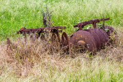 Rusty Old Texas Metal Farm Equipment in Field Stock Image