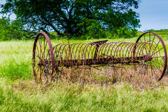 Rusty Old Texas Metal Farm Equipment in Field Royalty Free Stock Photography