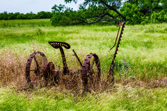 Rusty Old Texas Metal Farm Equipment In Field Royalty Free Stock Image