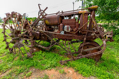Rusty Old Texas Tractor with Metal Tires. Off the Highway in Texas Royalty Free Stock Photography