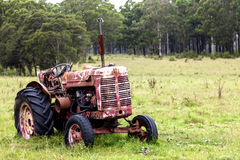 Rusty old tractor in field Royalty Free Stock Photo