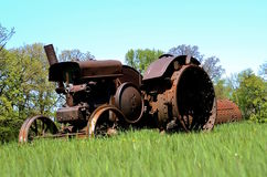Rusty old tractor with huge wheels Royalty Free Stock Photos