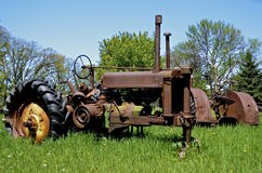 Rusty old tractor missing front tires Stock Image