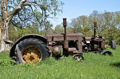 Rusty old tractors lined up. Stock Photos