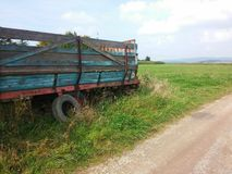 Rusty old trailer on the field Royalty Free Stock Image