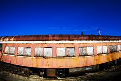 Rusty old train. A rusty old train car under a bright blue sky Stock Images