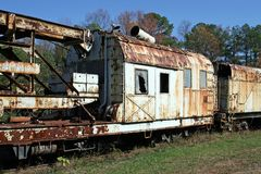 Rusty Old Train Cars. Old train cars out in the field with paint peeling and rust formation. Southeastern Railroad Museum, Duluth Ga Royalty Free Stock Photos
