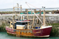 Rusty Old Trawler. Rusty old fishing boat tied up in harbour Royalty Free Stock Image
