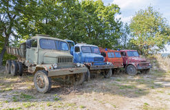 Rusty Old Trucks parked in forest Stock Photo
