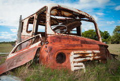 Rusty old van wreck. A van produced in the 1950's and 1960's left to rust in a field Royalty Free Stock Images