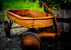 Rusty old wagon. A rusty classic wagon outdoors Stock Photography