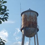 Rusty old water tower Royalty Free Stock Photos