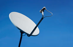 Rusty old white satellite dishes on blue sky background Royalty Free Stock Photo
