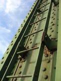 Rusty old worn green industrial ladder Stock Photos