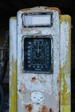 A rusty old yellow petrol pump. A rusty old single yellow petrol pump, with a large dial showing gallons stock photos