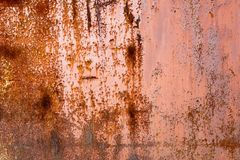 Rusty orange background. Rust texture on an old metal wall. Grunge rusted metal texture. Rusty corrosion and oxidized background.