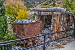 Rusty Ore Cart and Adit. In an old mining town stock photography
