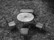 Rusty outdor furniture in the yard b&w. Newspaper wallpaper or background is very good Stock Photography