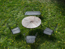 Rusty outdor furniture in the yard. Newspaper wallpaper or background is very good Stock Images