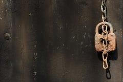 Rusty padlock. Photograph of a rusty padlock on a black background Stock Photos