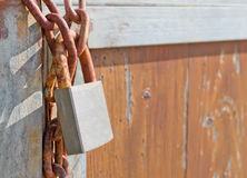 Rusty padlock. And chain on an old gate Royalty Free Stock Photography