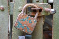 Rusty padlock that closes the scratch of an ancient prison o Stock Photo