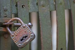 Rusty padlock that closes the scratch of an ancient prison o stock photography