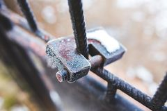 Rusty padlock covered with hoarfrost ice crystals Stock Photos