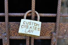 Rusty padlock on iron grid. Stock Photos