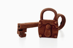 Rusty padlock and matching key on white background Royalty Free Stock Photos