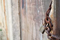 Rusty padlock and metal chain Stock Image