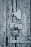 Rusty padlock on an old painted wooden gate Royalty Free Stock Photos
