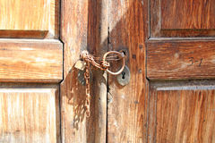 Rusty padlock on old wooden door Royalty Free Stock Photography