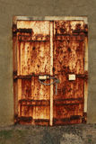 Rusty padlocked door Royalty Free Stock Photos