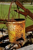 Rusty pail hangs on a lever Stock Photo