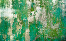 Rusty painted green metal texture with cracked paint. Stock Images