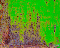 Rusty painted metal with cracked paint. Orange, brown and green. Colors. Texture color grunge background stock photo