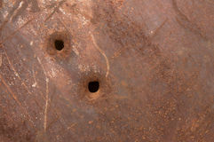 Rusty panel with bullet holes. Rusty metal sheet with bullet holes Stock Photography