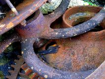 Rusty parts of an old steam engine stock photography