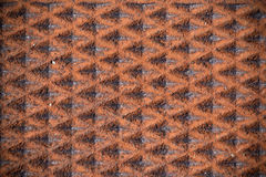 Rusty patterned background on man-hole cover Royalty Free Stock Images
