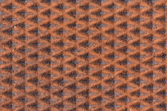 Rusty patterned background on man-hole cover Stock Photography