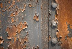 Rusty peeling paint background. Rusty grungy peeling paint background stock images