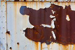 Rusty, peeling piece of steel for a background or grunge effect Stock Images