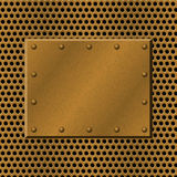 Rusty perforated Metal Background with plate and rivets. Metallic grunge texture. Brass, copper latticed template. Stock Photo