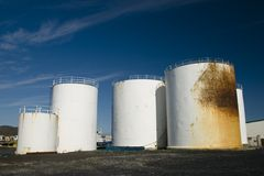 Rusty petrol tanks. In harbour Stock Images