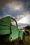 Rusty Pickup. Green rusty vintage farm car royalty free stock photo