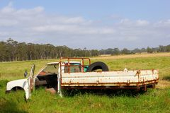 Decayed pickup car fields, Australia. A rusty pick up car wreck is abandoned in the fields in Western Australia royalty free stock photos